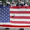 US pays tribute to 9/11 victims as pandemic forces socially distanced commemorations