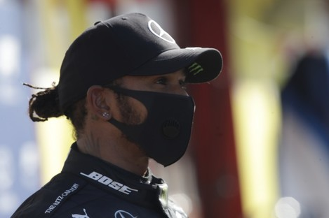 Mercedes driver Lewis Hamilton of Britain wears the face mask.