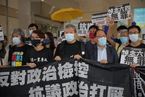 Hong Kong pro-democracy activists speaking to media outside court today.
