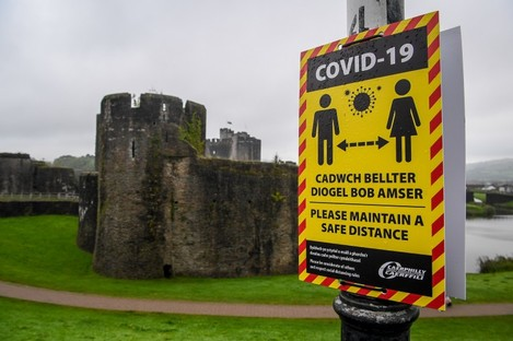 Covid-19 signage opposite Caerphilly castle.