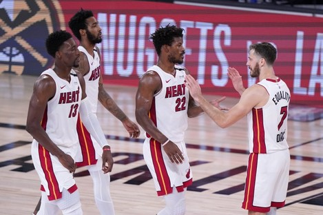 Miami Heat players celebrate after the game.