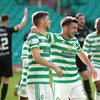 Celtic score two goals in three minutes and hold off late rally in five-goal battle to go top