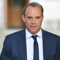 UK protection officer travelling with Dominic Raab suspended after leaving gun on plane