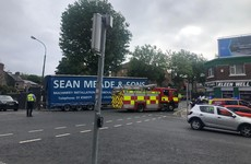 Pedestrian seriously injured after being struck by falling traffic light that was hit by a truck