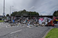 Road blocked after rubbish truck overturns in Liffey Valley