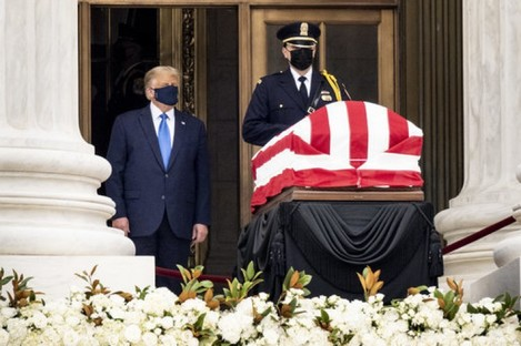 Trump pays respects to Ginsburg beside her coffin at the Supreme Court building.