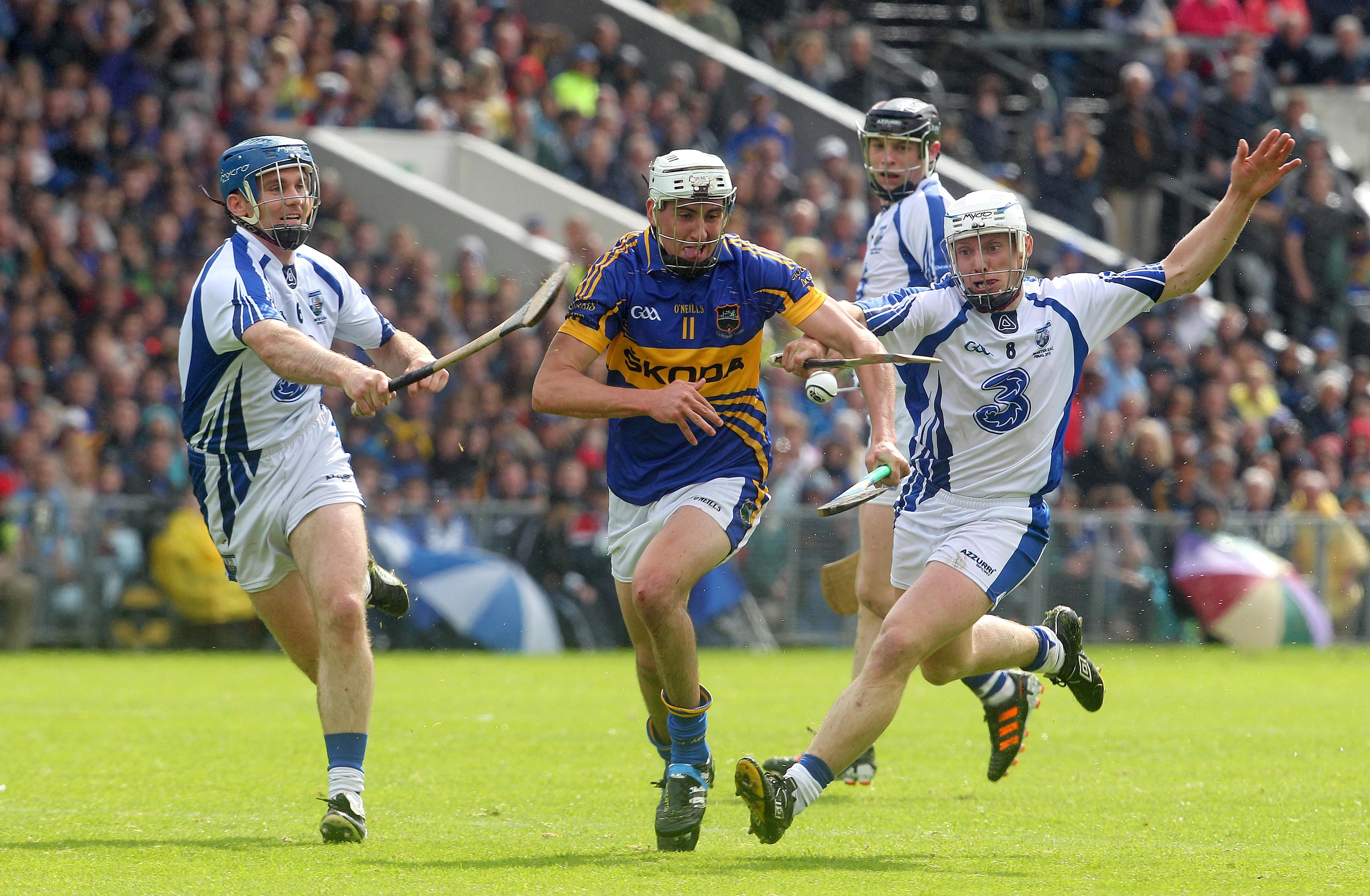 Tipperary's Patrick Maher tackled by Michael Walsh and Stephen Molumphy of Waterford.