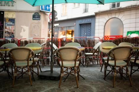 An empty terrace of a Paris bar.
