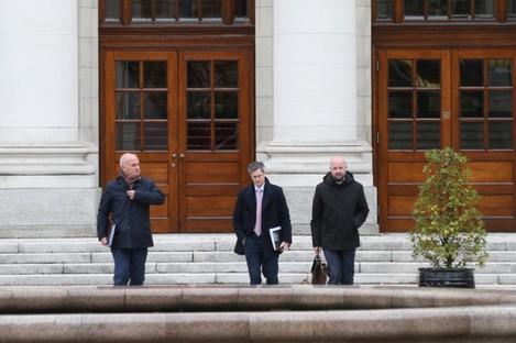 Tony Holohan, Ronan Glynn and Philip Nolan leaving Government Buildings yesterday.