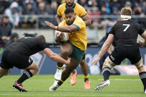 Australia's Taniela Tupou takes on New Zealand's Joe Moody and Sam Cane during Sunday's game in Wellington.