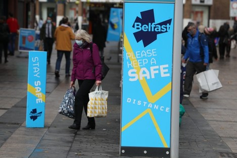 A woman wearing a face mask in Belfast city centre.