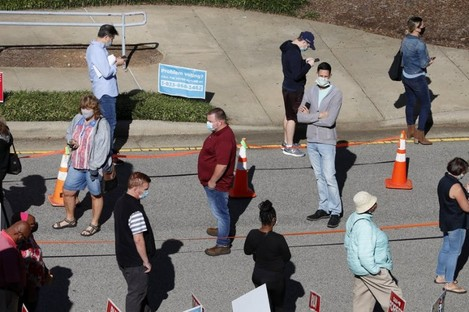 Voters wait in line outside a voting centre in North Carolina.