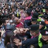 Thailand's prime minister refuses to quit in face of mass protests amid state of emergency