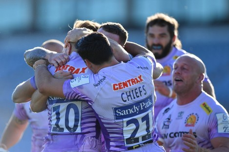 Exeter Chiefs' players celebrate their Champions Cup semi-final win over Toulouse.