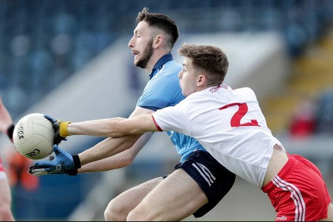 Dublin's Ciaran Archer is tackled by Cormac Quinn of Tyrone.