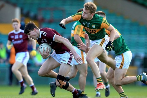 Galway's Matthew Tierney is tackled by Kerry's Alan Dineen.