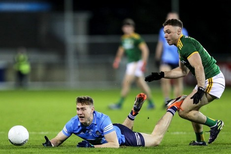 Dublin's John Small is tackled by David Toner of Meath.