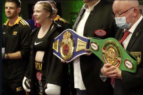 Katelynn Phelan smiles during the national anthem prior to her sensational victory over Jessica Schadko.