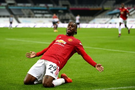 Manchester United's Aaron Wan-Bissaka celebrates his side's third goal.