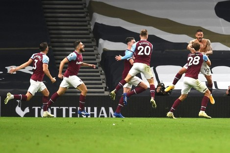 West Ham players celebrate their late equaliser.