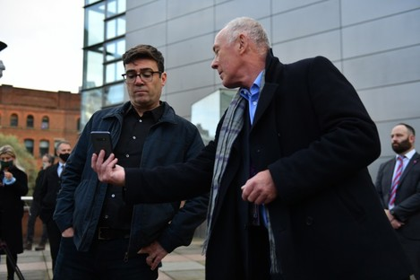 Manchester mayor Andy Burnham is shown a text message by the leader of Manchester City Council of when the restrictions will come into force.