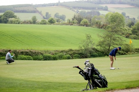 Members of the public playing golf at Bunclody golf club while adhering to social distancing.