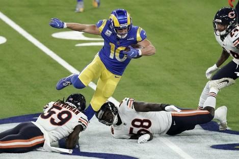 Rams wide receiver Cooper Kupp, top, leaps over Bears inside linebacker Danny Trevathan (59).