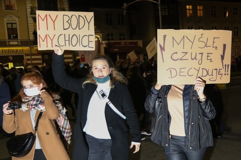Protesters with pro-choice and anti-government slogans marching yesterday in Gdansk, Poland.