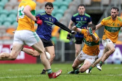 Mayo's Tommy Conroy scores a goal despite the efforts of Aidan Flynn of Leitrim.