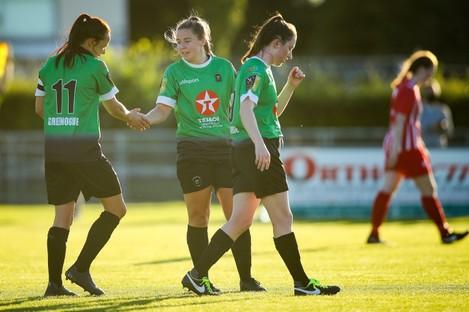 Eleanor Ryan Doyle celebrates a goal with Áine O'Gorman.
