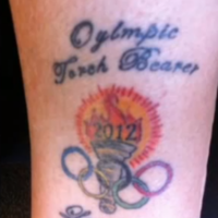 Olympic torchbearer gets tattoo to celebrate... but there's just one problem