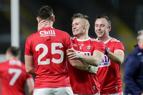Paul Kerrigan (right) celebrates with team-mates Mark Keane and Kevin Flahive after Cork's win.