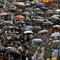 GALLERY: The world takes cover from heavy rain