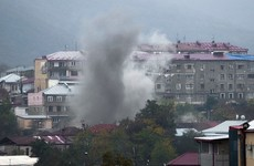 Azerbaijan apologises to Russia after shooting down helicopter as fighting rages over Karabakh