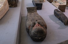 Egypt unveils ancient coffins and mummies found in huge necropolis