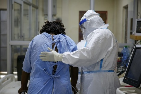A medical worker attends to a coronavirus patient in a Nairobi hospital