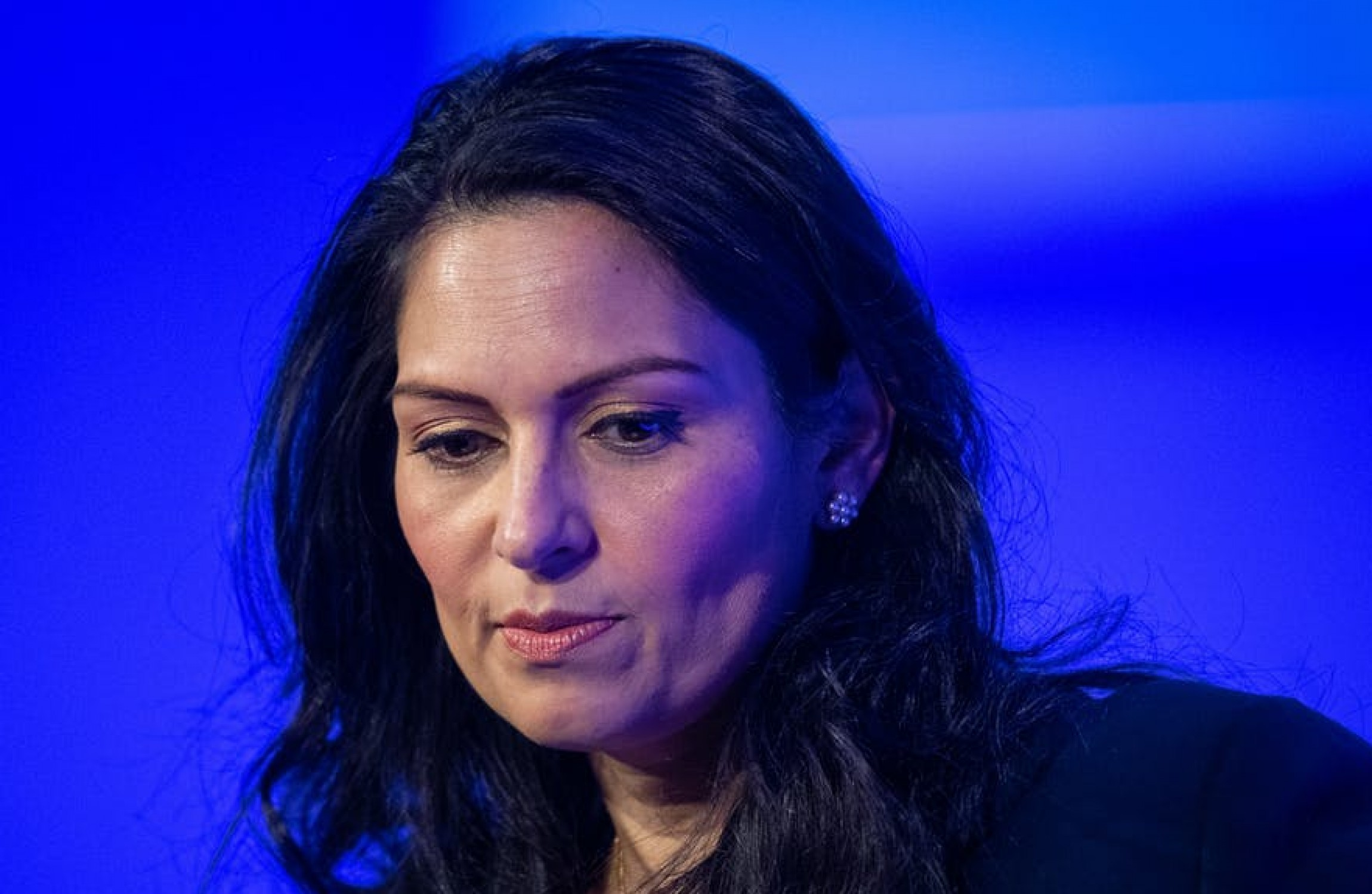 UK PM says he backs interior minister after inquiry into her conduct