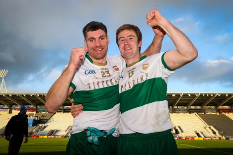 Tipperary footballers Philip Austin and Brian Fox celebrate after yesterday's Munster final.