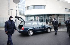 Car with 'stop the globalisation policies' written on it hits gate outside Merkel's offices