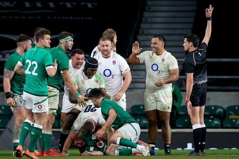 England celebrate a turnover against Ireland.