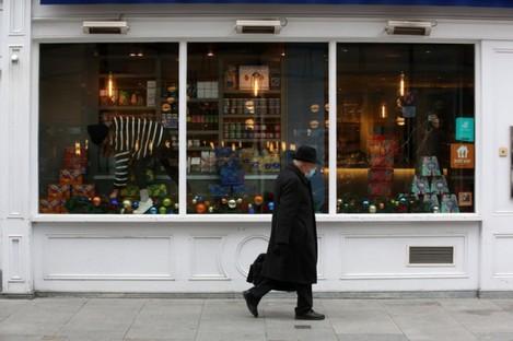 A man walks past a shop in Dublin