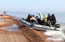 UK and France sign agreement to curb number of migrants crossing English Channel in boats