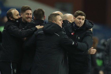 Rangers manager Steven Gerrard (right) celebrates with his staff.