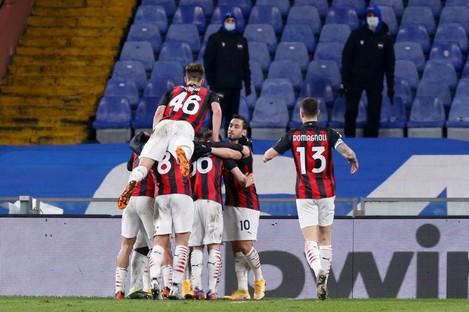 Frank Kessie and team-mates celebrate Milan's opening goal.