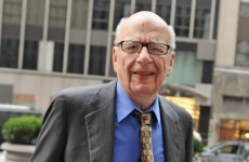 Murdoch resigns from boards of UK newspapers
