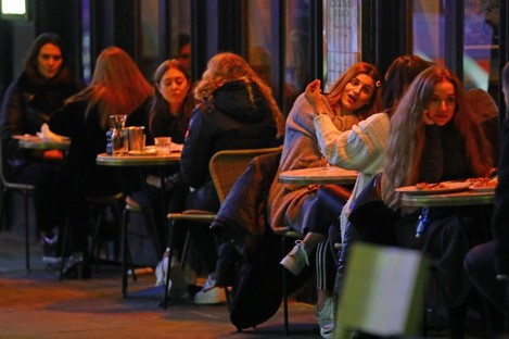 People dining outdoors in London yesterday.