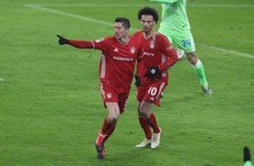 Lewandowski double keeps Bayern in touch with leaders Leverkusen