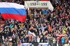 Russia's doping ban halved but name and flag barred from next two Olympics