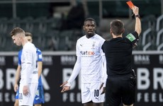 Gladbach fine player a month's wages for spitting at opponent