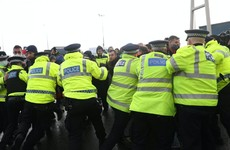 Man arrested as stranded lorry drivers clash with police in England